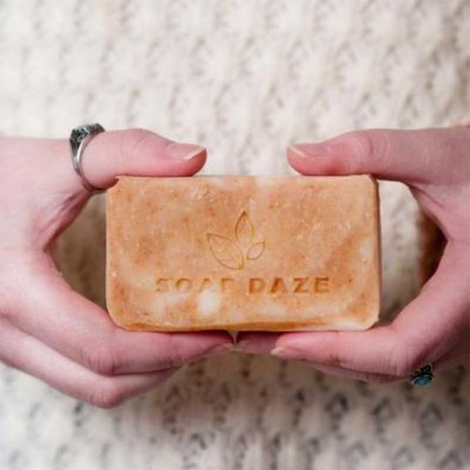 woman holding natural handmade soap in hands