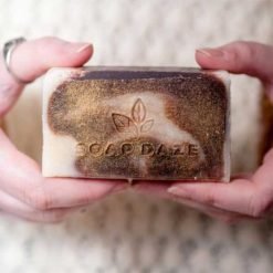 unboxed large natural soap bar in ladies hand