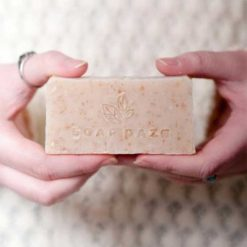 woman holding sustainable soap bar without packaging