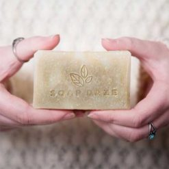 woman holding natural bar of soap with hands