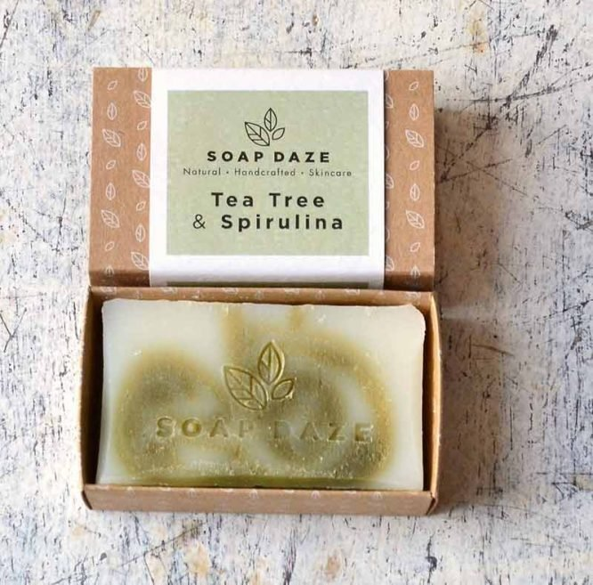natural bar of soap in cardboard packaging