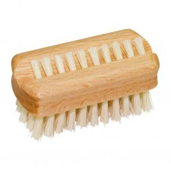 mini wooden nail brush on white background