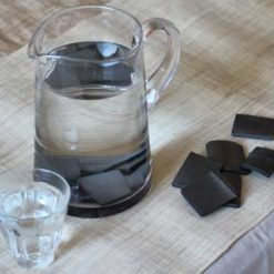 bamboo charcoal water filter in glass jug of water