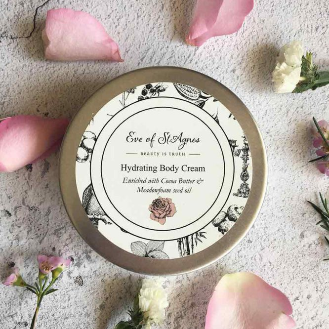 plastic free body cream next to rose petals