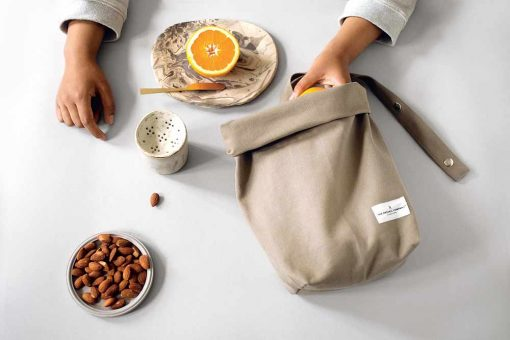 organic cotton lunch bag on a table with food