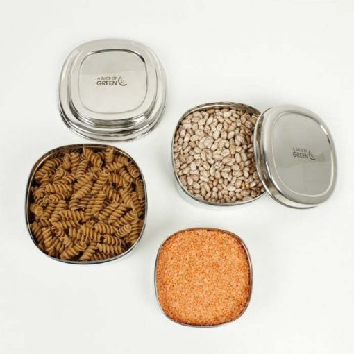 food containers with pasta and grains inside