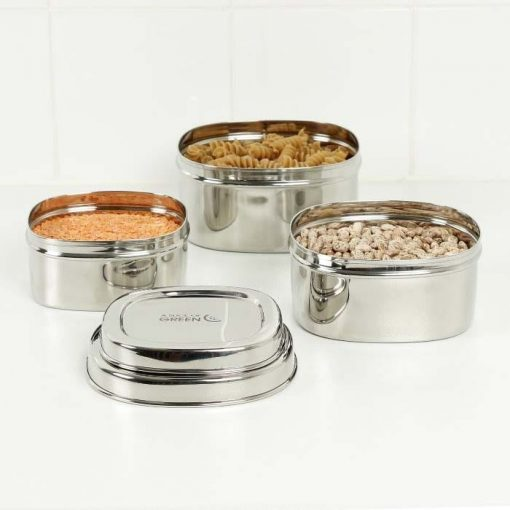square stainless steel containers arranged on a table