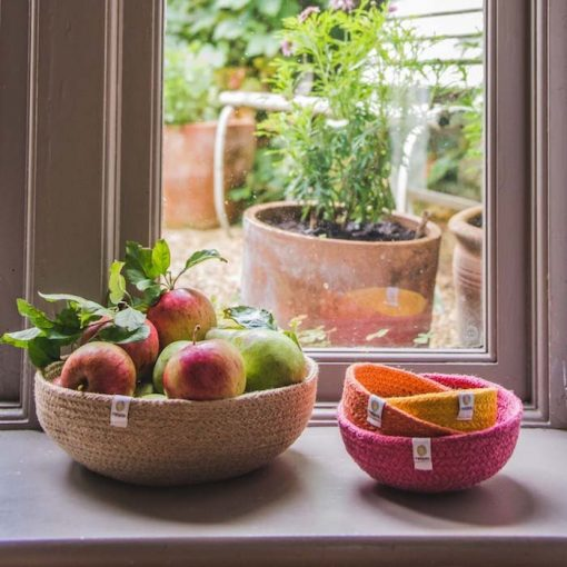 set of 3 jute bowls next to fruit bowl