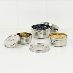 round stainless steel food containers with houmous and dips