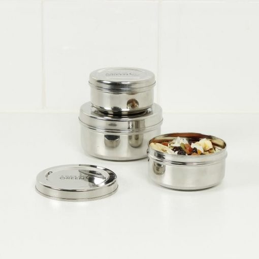 stainless steel food containers arranged on a table