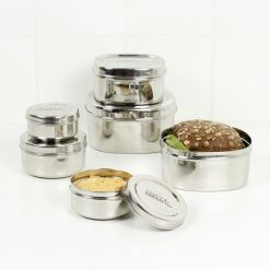 round stainless steel food containers arranged together