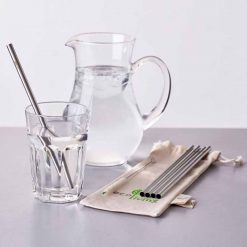 stainless steel drinking straws next to jug of water