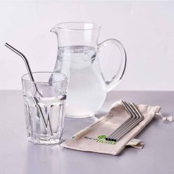 stainless steel straws next to jug of water