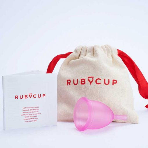 ruby cup period cup next to cotton bag