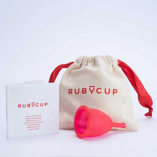 red ruby cup menstrual cup beside drawstring pouch