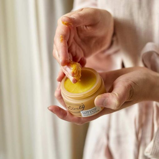 organic cleansing face balm in womans hand