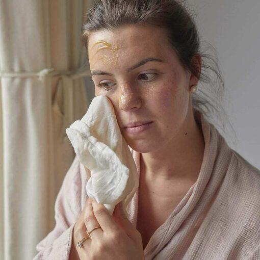 woman using organic muslin cloths