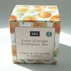 fizzy orange shampoo bar in cardboard packaging