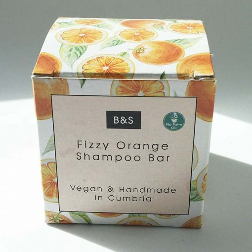 fizzy orange shampoo bar in cardboard packaging
