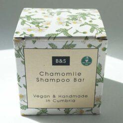 camomille shampoo bar in cardboard packaging