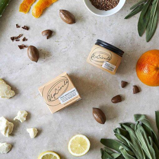 natural face moisturiser next to cocoa butter