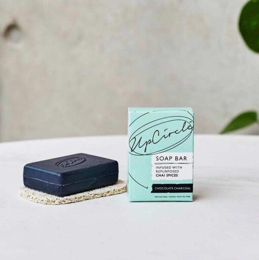 organic charcoal soap bar on a soap dish