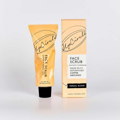 coffee face scrub next to packaging