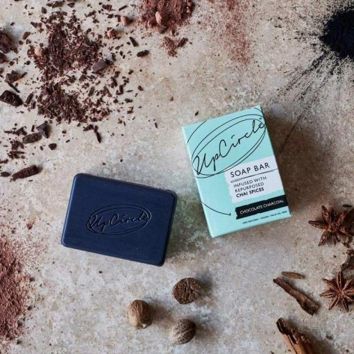 organic charcoal soap bar next to packaging
