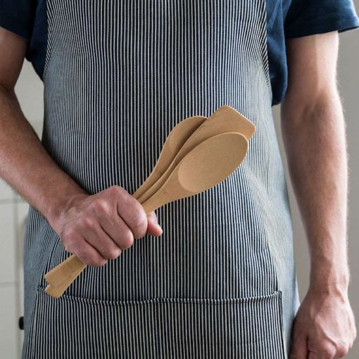 cheif holding bamboo utensil set