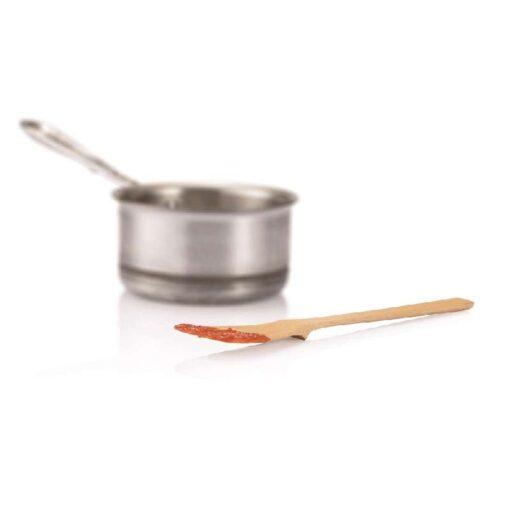 bamboo spatula laying next to a saucepan