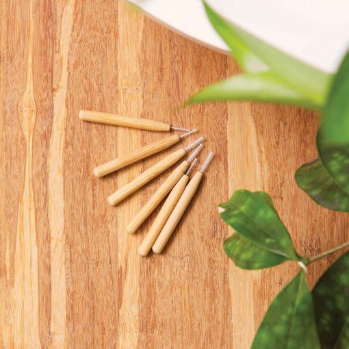 bamboo interdental brushes on wood surface