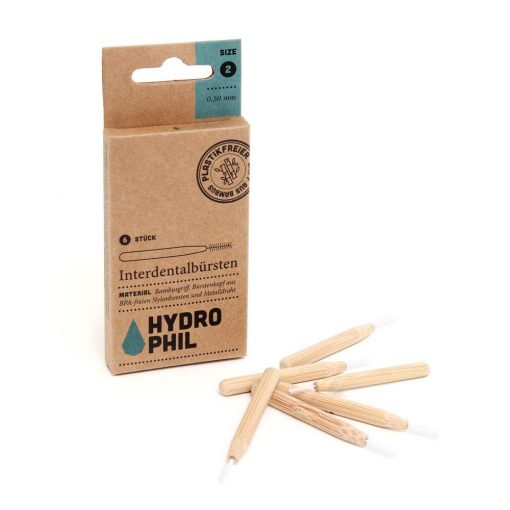 bamboo interdental brushes next to packaging