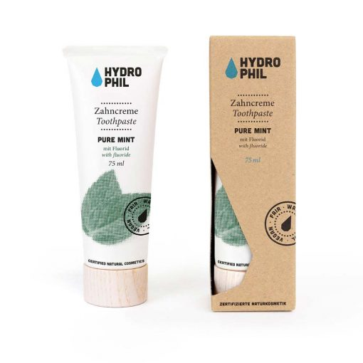 pure mint toothpaste next to packaging