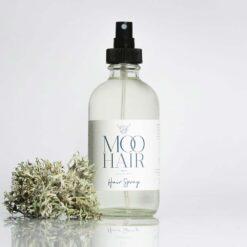 moo hair spray in glass bottle