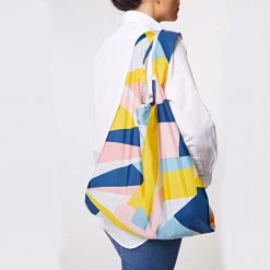 woman carrying reusable shopping bag