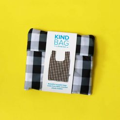reusable shopping bag in pouch on yellow background