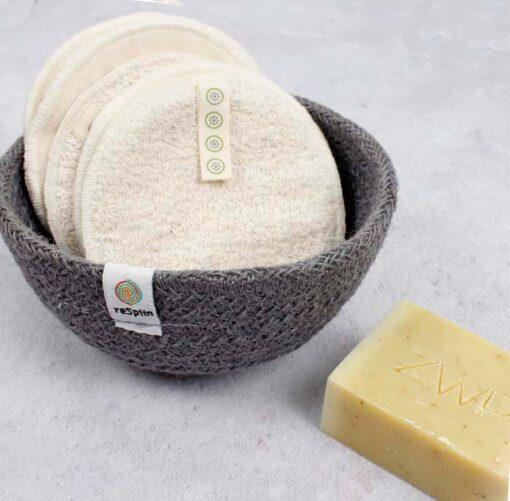 large cotton facial pads in a jute bowl
