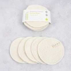 large cotton facial pad next to packaging