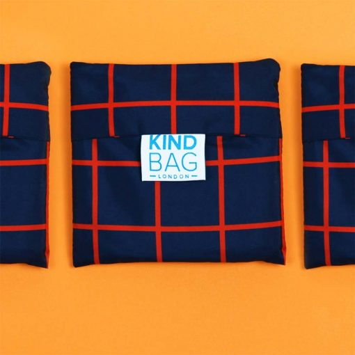 reusable shopping bag on orange background
