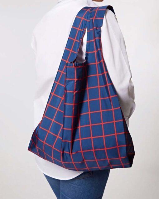 reusable shopping bag over a woman's shoulder