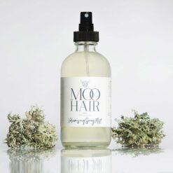 volumising hair spray in glass bottle