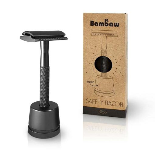 metal safety razor on a stand