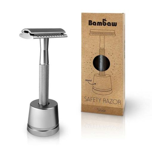 silver safety razor on a stand