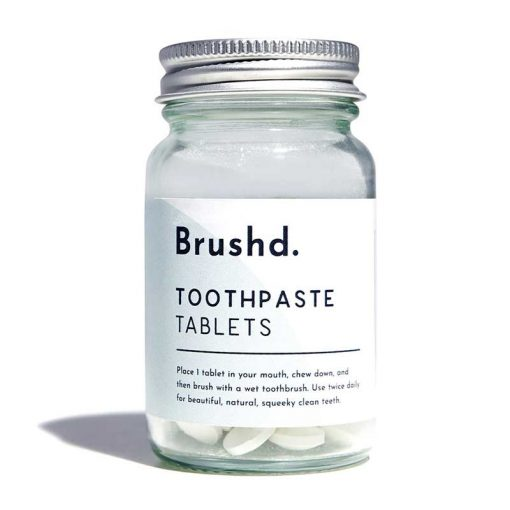 fluoride free toothpaste tablets on white backgrounf