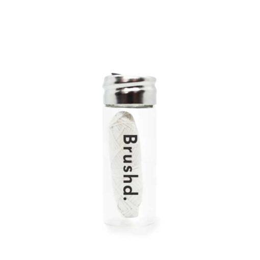 plastic free dental floss in glass jar
