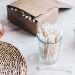 biodegradable cotton buds in a small glass