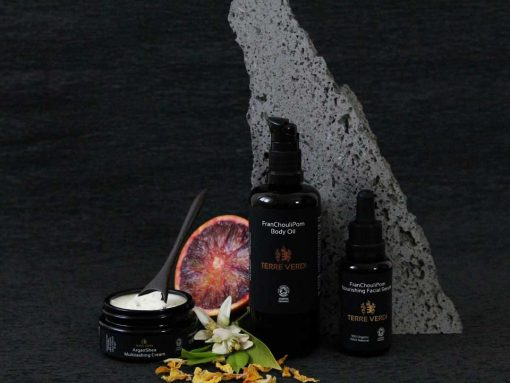 organic multitasking cream next to other skincare products
