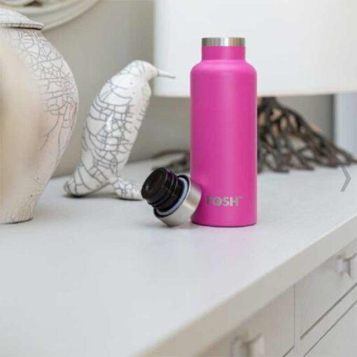 pink water bottle on kitchen side