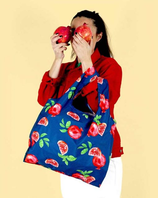 woman holding a pomegranate shopping bag