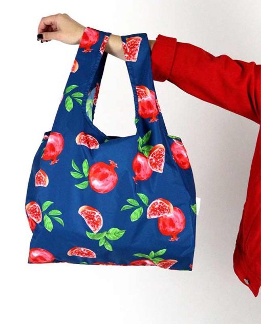 shopping bag hanging from womans arm